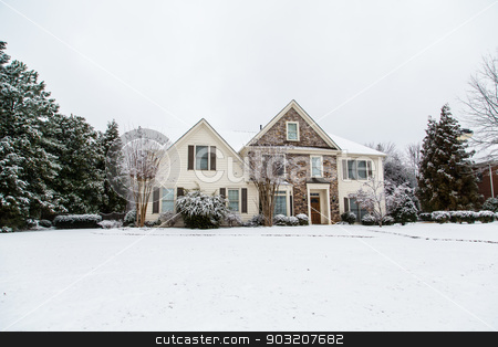 Nice Stone and Siding House After Heavy Snow stock photo, A nice house after a snow storm by Darryl Brooks