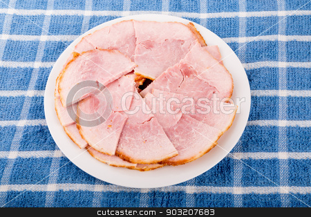 Sliced Ham on a White Plate and Blue Towel stock photo, Fresh Ham baked with sweet honey crust by Darryl Brooks