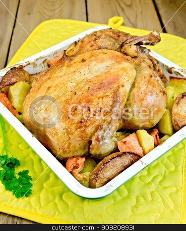 Chicken baked with vegetables in tray and parsley stock photo, Chicken baked with potatoes, carrots and apples in a tray with parsley, potholder on the background of wooden boards by rezkrr