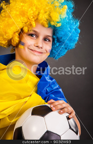 Football fan with  ukrainian flag on a black background stock photo, Football fan with a blue and yellow ukrainian flag painted on his face on black background by bloodua