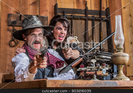 Weapons Drawn in Saloon stock photo, A Shouting Cowboy and Saloon Girl Point Their Weapons at You by Scott Griessel