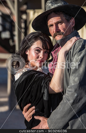 Gruff Man and Woman stock photo, Portrait of an old west woman and sheriff by Scott Griessel