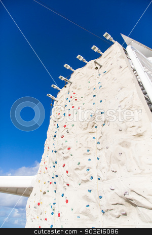 Rock Climbing Wall Under Blue Sky with Bell at Top stock photo, Rock climbing wall on a luxury cruise ship by Darryl Brooks