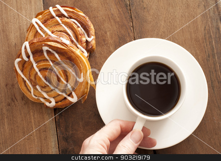 Coffee with fresh Danish pastries stock photo, Man reaching for a cup and saucer of full roast espresso coffee with fresh Danish pastries for a refreshing coffee break, high angle view on wood by Stephen Gibson