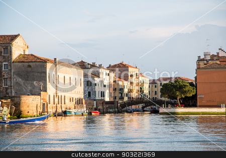 Old Blue and Red Boats in Venice Canal stock photo, Boats docked along a canal in Venice, Italy by Darryl Brooks