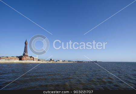 View of Blackpool seafront from the ocean stock photo, View of Blackpool seafront from the ocean showing the sandy beach dominated by the tall Victorian Blackpool tower at this popular Lancashire resort on a clear blue sunny day by Stephen Gibson