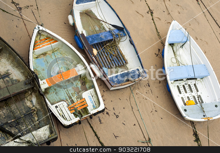 Small wooden boats in St Ives harbour stock photo, Small wooden boats beached high and dry on the sand by the retreating tide in St Ives harbour in Cornwall a popular fishing village and tourist resort by Stephen Gibson