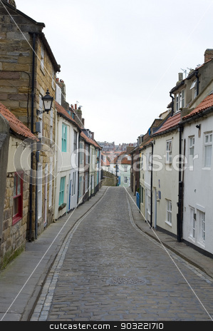 Henrietta Street, Whitby stock photo, View along the length of the narrow cobbled Henrietta Street, Whitby, North Yorkshire with its traditional historical English cottages by Stephen Gibson