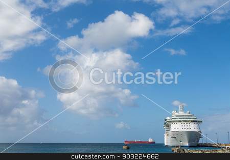 Empty Red Freighter Beyond White Cruise Ship stock photo, White Luxury Cruise Ship Docked at St Croix by Darryl Brooks