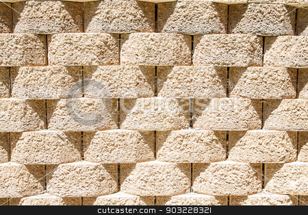 Round Interlocking Block Wall stock photo, A wall of interlocking stone blocks for background or texture by Darryl Brooks