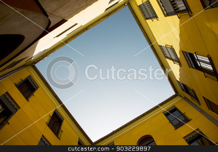 Yellow old building facade with blue sky stock photo, Yellow old building facade with blue sky. Horizontal by ABBPhoto