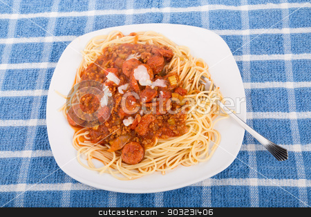 Spaghetti with sausage and pasta twirled on fork stock photo, Fresh plate of delicious spaghetti with beef and sausage  meat sauce and parmesan cheese by Darryl Brooks