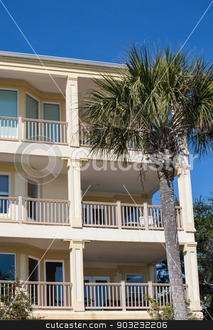 Condo Balconies and Palm Tree stock photo, A three story stucco condo with balconies and a palm tree by Darryl Brooks