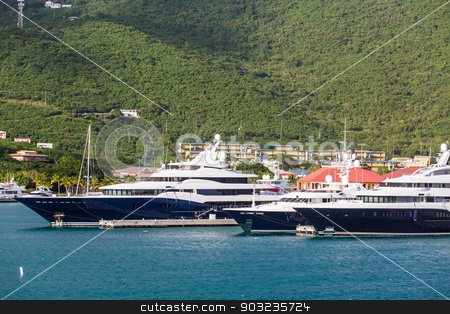 Blue and White Yachts at St Thomas stock photo, Huge Luxury Yachts in the harbor at St Thomas by Darryl Brooks