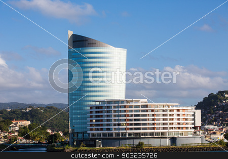 Curved Modern Glass Condos in Martinique stock photo, Amodern glass and steel resort hotel and condo on the coast of Martinique by Darryl Brooks