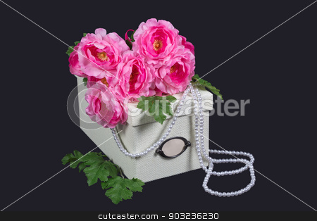 White box, pink flowers and pearl beads stock photo, White box, pink flowers and pearl beads on gray by AntMishch