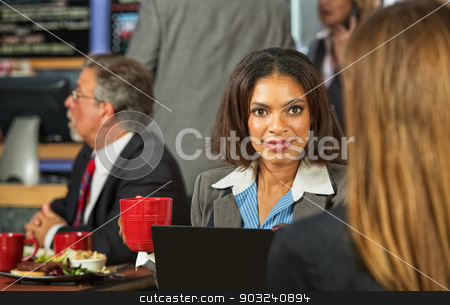 Woman Listening to Coworker stock photo, Young business woman listening to woman in cafeteria by Scott Griessel