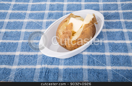 Hot Fluffy Baked Potato with Butter stock photo, A hot, buttered baked potato with creamery butter by Darryl Brooks