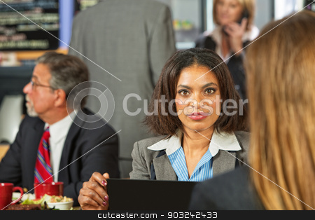 Business Woman in Cafe stock photo, Beautiful Black business woman with laptop in cafe by Scott Griessel