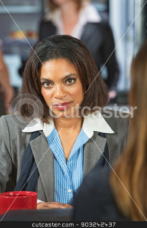 Calm Business Woman stock photo, Calm Black woman talking with friend in cafe by Scott Griessel