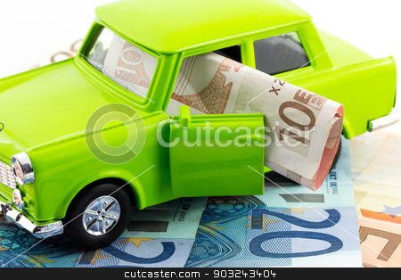 Car expenses stock photo, Green car over euro notes  by Federica Tremolada