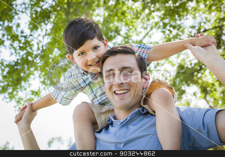 Father and Son Playing Piggyback in the Park stock photo, Mixed Race Father and Son Playing Piggyback Together in the Park. by Andy Dean