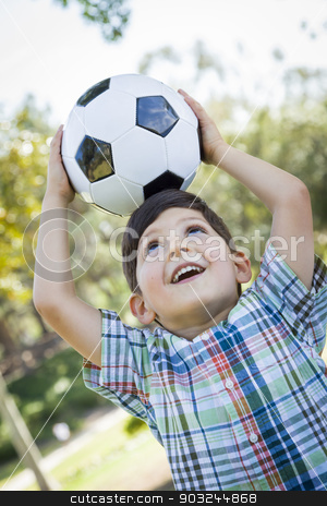 Cute Young Boy Playing with Soccer Ball in Park stock photo, Cute Young Boy Playing with Soccer Ball Outdoors in the Park. by Andy Dean
