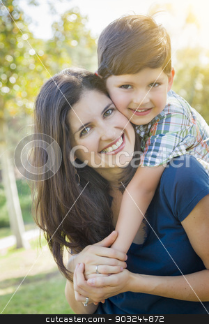 Attractive Mixed Race Mother and Son Hug in Park stock photo, Attractive Young Mixed Race Mother and Son Hug Outdoors in the Park. by Andy Dean