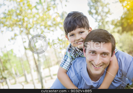 Father and Son Playing Together in the Park stock photo, Mixed Race Father and Son Playing Together in the Park. by Andy Dean