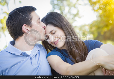 Young Attractive Couple Portrait in Park stock photo, Young Attractive Couple Intimate Portrait Outdoors in the Park. by Andy Dean