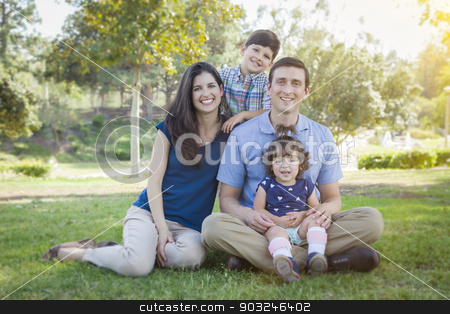 Attractive Young Mixed Race Family Outdoor Park Portrait stock photo, Attractive Young Mixed Race Family Outdoor Portrait in the Park. by Andy Dean