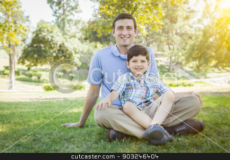 Handsome Mixed Race Father and Son Park Portrait stock photo, Handsome Mixed Race Father and Young Son Portrait in the Park. by Andy Dean