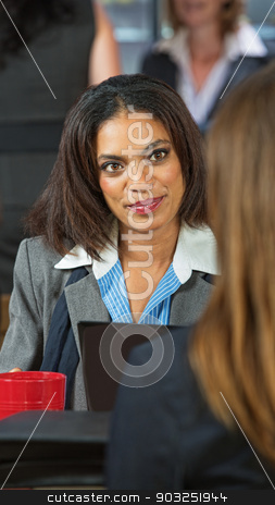 Happy Executive Female stock photo, Happy business woman talking with friend in cafe by Scott Griessel