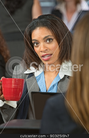 Concerned Woman with Coffee stock photo, Concerned young business woman holding coffee cup by Scott Griessel