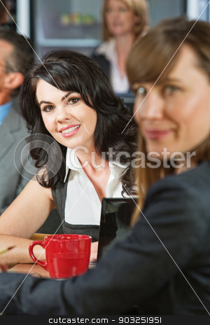 Business Woman in Cafe stock photo, Cheerful young white female with friend in cafe by Scott Griessel