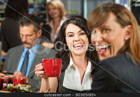 Laughing Women in Cafe stock photo, Pair of laughing business women with coffee in restaurant by Scott Griessel