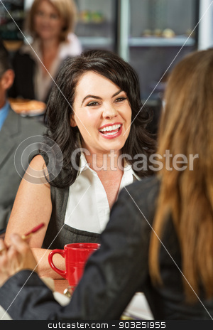 Cheerful Ladies Laughing stock photo, Two business women laughing and talking in coffee house by Scott Griessel