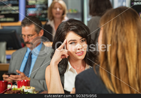 Skeptical Female in Cafe stock photo, Skeptical woman with friend in coffee house by Scott Griessel