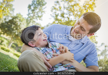 Loving Father Tickling Son in the Park stock photo, Loving Young Father Tickling Son in the Park. by Andy Dean