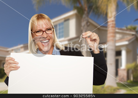 Excited Woman Holding House Keys and Blank Real Estate Sign stock photo, Excited Woman Holding House Keys and Blank Real Estate Sign in Front of Nice New Home. by Andy Dean