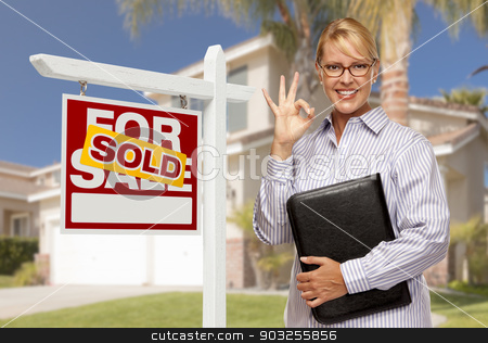 Real Estate Agent in Front of Sold Sign and House stock photo, Attractive Female Real Estate Agent in Front of Sold Home For Sale Sign and House. by Andy Dean