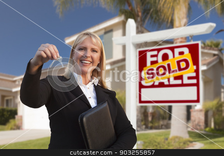 Female Real Estate Agent Handing Over the House Keys stock photo, Female Real Estate Agent Handing Over the House Keys in Front of a Beautiful New Home and Real Estate Sign. by Andy Dean