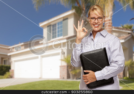 Attractive Businesswoman In Front of Nice Residential Home stock photo, Attractive Businesswoman with Okay Hand Sign In Front of Nice Residential Home. by Andy Dean