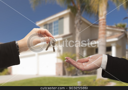 Handing Over The Keys and New House stock photo, Handing Over The New House Keys with Home in the Background. by Andy Dean