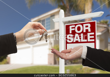 Agent Handing Over House Keys in Front of New Home stock photo, Real Estate Agent Handing Over the House Keys in Front of a Beautiful New Home and For Sale Real Estate Sign. by Andy Dean