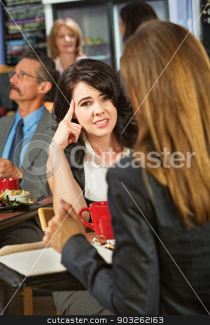 Bored Lady in Cafe stock photo, Bored woman with coworker in coffee house by Scott Griessel