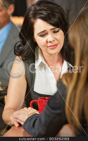 Crying Woman in Cafe stock photo, Crying young Caucasian woman with sympathetic friend by Scott Griessel