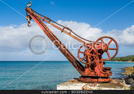 Old Rusty Red Crane in St Croix stock photo, An old rusty, red crane on the island of St Croix by Darryl Brooks