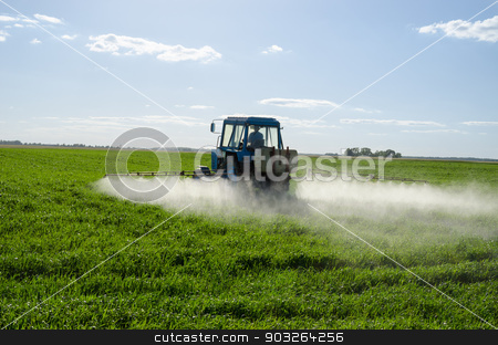 Tractor spray fertilize field pesticide chemical  stock photo, Tractor spray fertilize green field with pesticide insecticide herbicide chemicals in agriculture field in evening sunlight. Farmer care plants.  by sauletas