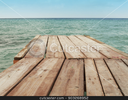 Wooden dock and Mediterranean sea with sky stock photo, Wooden dock and Mediterranean sea with sky. Horizontal by ABBPhoto